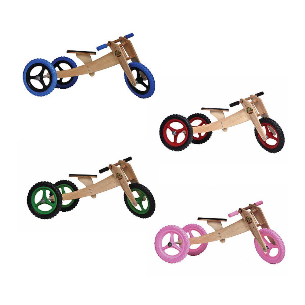 Quatro bicicletas com três rodas nas cores azul, vermelha, verde e rosa